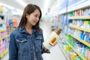 Woman buy thing in supermarket